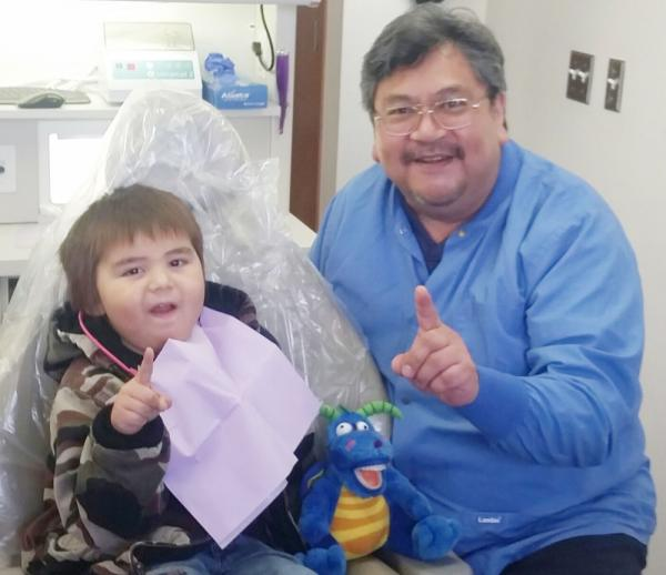 DHAT Daniel Kennedy seeing his first patient at the Swinomish Dental Clinic